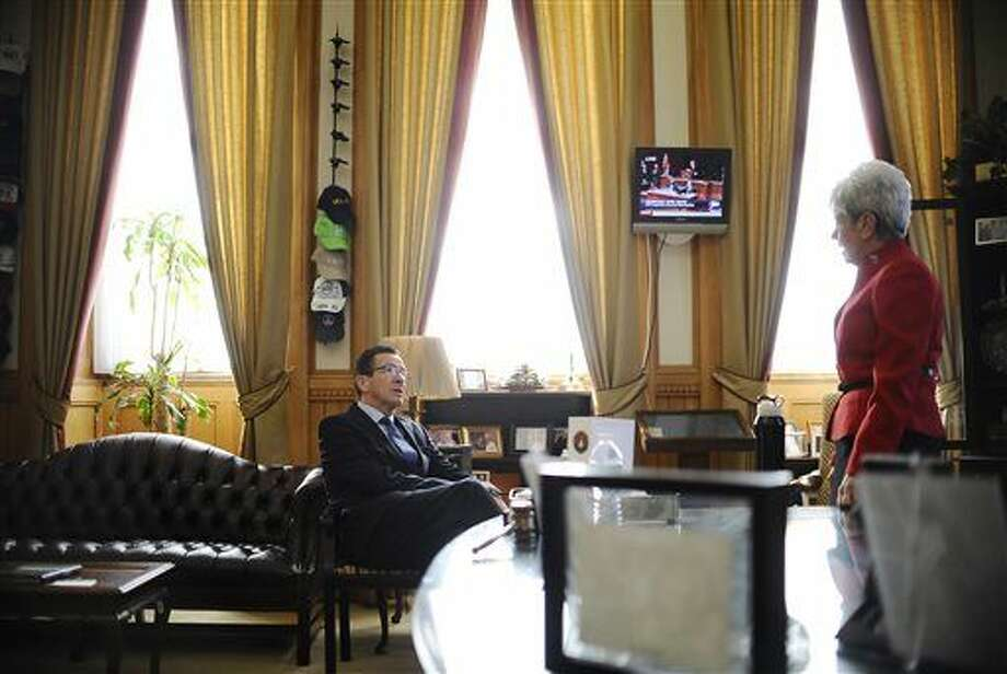 Connecticut Gov. Dannel P. Malloy, left, talks with Lt. Gov. Nancy Wyman, right, as they wait in her office for Wyman to be sworn in of a second term at the State Capital, Wednesday, Jan. 7, 2015, in Hartford.