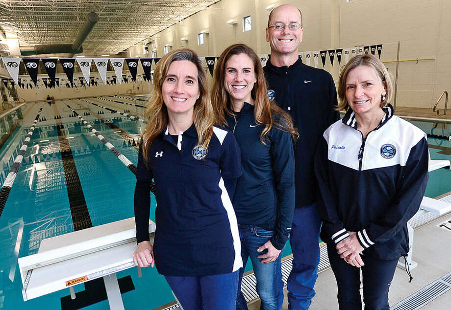 Hour photo / Erik Trautmann The Swim Seventy Aquacenter owners Toni Phillips and Ashlee Bunt, head swim coach, Stu Wilson, and triathalon director, Pascale Butcher. The Center will feature a 27,000 sqaure foot facilty with a 6 lane, 50 meter lap pool, a 30×60 warm water lesson and fitness pool, an endless pool for stroke analysis and therapy, a dedicated triathlon training center and yoga studio.