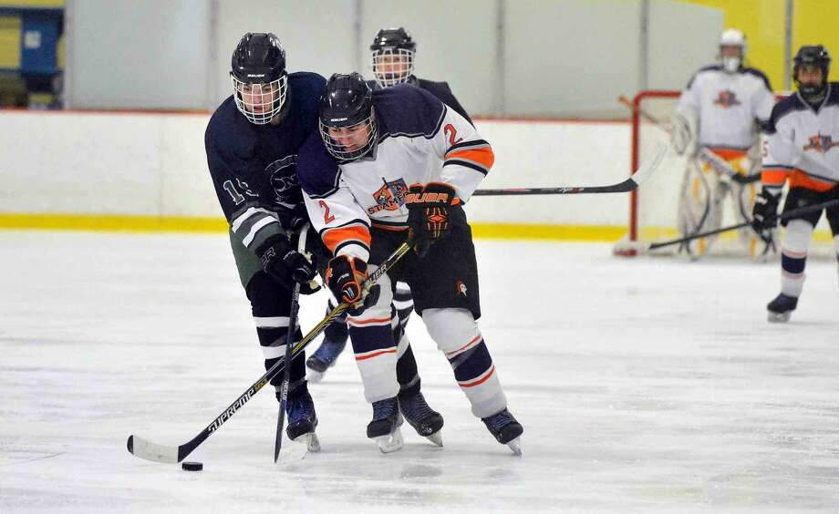 Hour Photo/Alex von Kleydorff Norwalk MacMahons # 15 Kevin Remson battles Stamford Co-Op's #2 Matt Tuccinardi