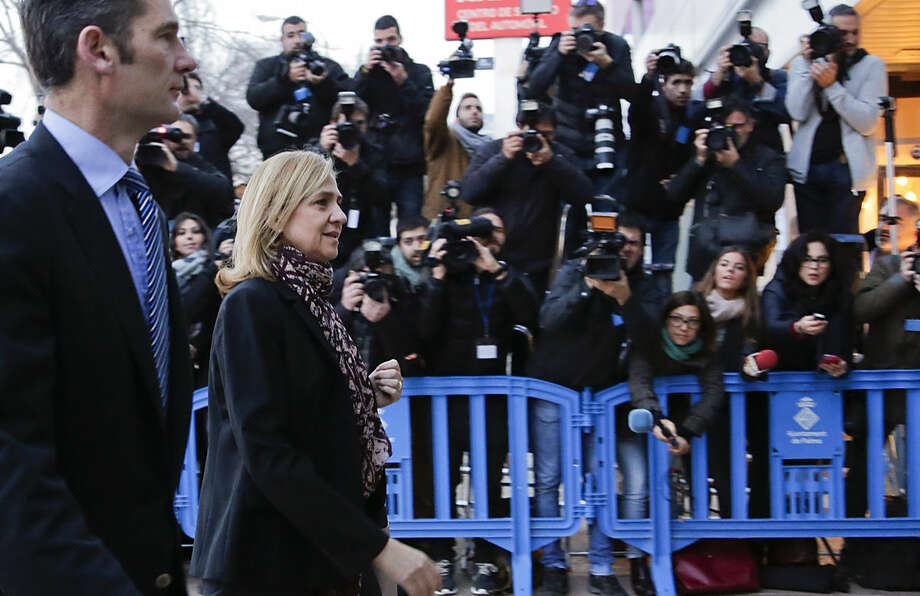 Spain's Princess Cristina and her husband Inaki Urdangarin arrive at a makeshift courtroom for a corruption trial, in Palma de Mallorca, Spain, Monday, Jan. 11, 2016. Princess Cristina and her husband are heading to court for the start of an historic trial that marks the first time a member of Spain's royal family has faced criminal charges since the monarchy was restored in 1975. (AP Photo/Emilio Morenatti)