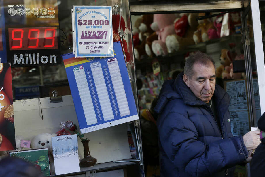 A sign advertising the Powerball lottery hangs on a store in New York, Monday, Jan. 11, 2016. The jackpot is so big that billboards around the country have to advertise the prize as $999 million because they're not built to show billions. (AP Photo/Seth Wenig)