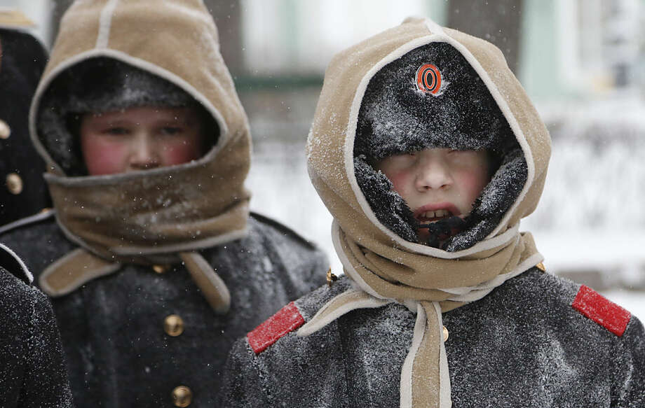 Pupils of Navy cadet classes walk in snow in St.Petersburg, Russia, Tuesday, Jan. 12, 2016. Low temperatures caused the two-days of snowfall in St.Petersburg. (AP Photo/Dmitry Lovetsky)