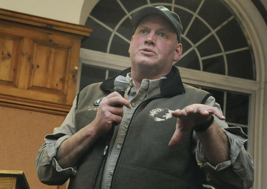 Hour photo/Matthew VinciPeter Reid, of Weston-based Wildlife in Crisis, speaks at the 2016 annual meeting of the Norwalk Land Trust on Monday at Norwalk City Hall.