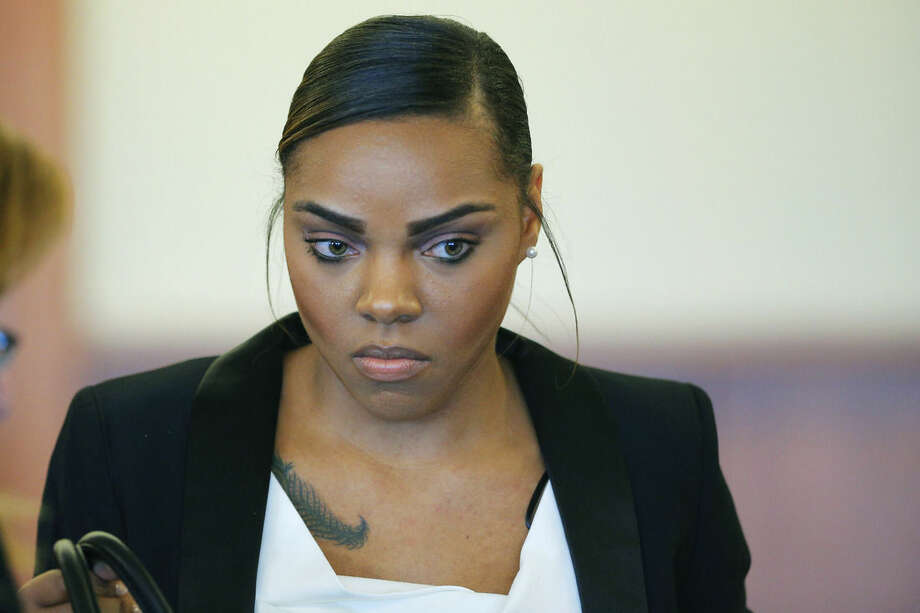 FILE - In this Dec. 22, 2014 file photo, Shayanna Jenkins, fiancee of former New England Patriots football player Aaron Hernandez, stands during a pretrial hearing in Fall River, Mass. Jenkins went before the judge Wednesday, Jan. 7, 2015, on a prosecutors' petition to grant her immunity in the case. She faces perjury charges for lying to a grand jury hearing the case against Hernandez, who is awaiting trial on charges of murdering Odin Lloyd in 2013. (AP Photo/Brian Snyder, Pool, File)