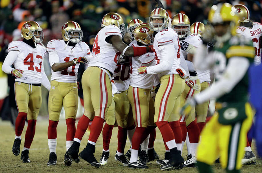 San Francisco 49ers players celebrates after San Francisco 49ers kicker Phil Dawson (9) kicks the game winning field goal during the second half of an NFL wild-card playoff football game, Sunday, Jan. 5, 2014, in Green Bay, Wis. The 49ers won 23-20. (AP Photo/Mike Roemer) / FR155603 AP