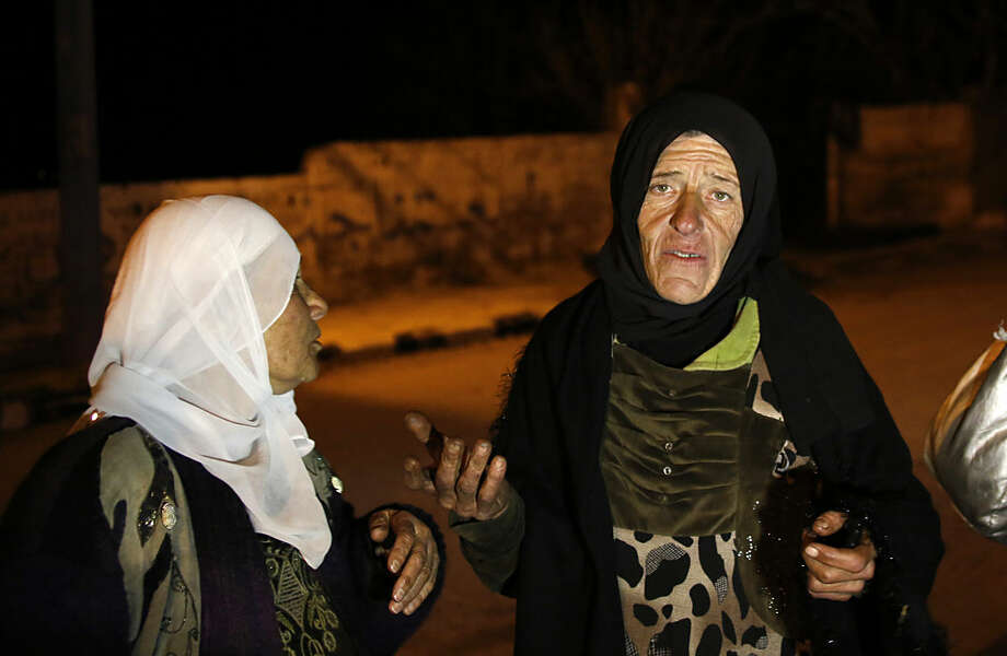In this Monday, Jan. 11, 2016 photo, residents talk to reporters in the besieged town of Madaya, northwest of Damascus, Syria. Aid convoys reached three besieged villages on Monday — Madaya, near Damascus, where U.N. humanitarian chief Stephen O'Brien said about 400 people need to be evacuated immediately to receive life-saving treatment for medical conditions, malnourishment and starvation, and the Shiite villages of Foua and Kfarya in northern Syria. Reports of starvation and images of emaciated children have raised global concerns and underscored the urgency for new peace talks that the U.N. is hoping to host in Geneva on Jan. 25. (AP Photo)