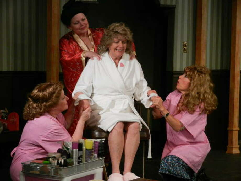 "Nothing takes the pressure off a bad day like a little pampering, and the girls of ""The Hallelujah Girls"" know that, as Christina Richardson (seated) is attended by her friends Cathy Cordaro (kneeling left) Cindy Hartog (standing), and Ruth Lettera."