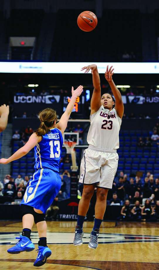 Connecticut's Kaleena Mosqueda-Lewis, right, shoots a 3-pointer over Tulsa's Ashley Hughes, left, during the second half of an NCAA college basketball game, Wednesday, Jan. 7, 2015, in Hartford, Conn. Connecticut won 98-60. (AP Photo/Jessica Hill)