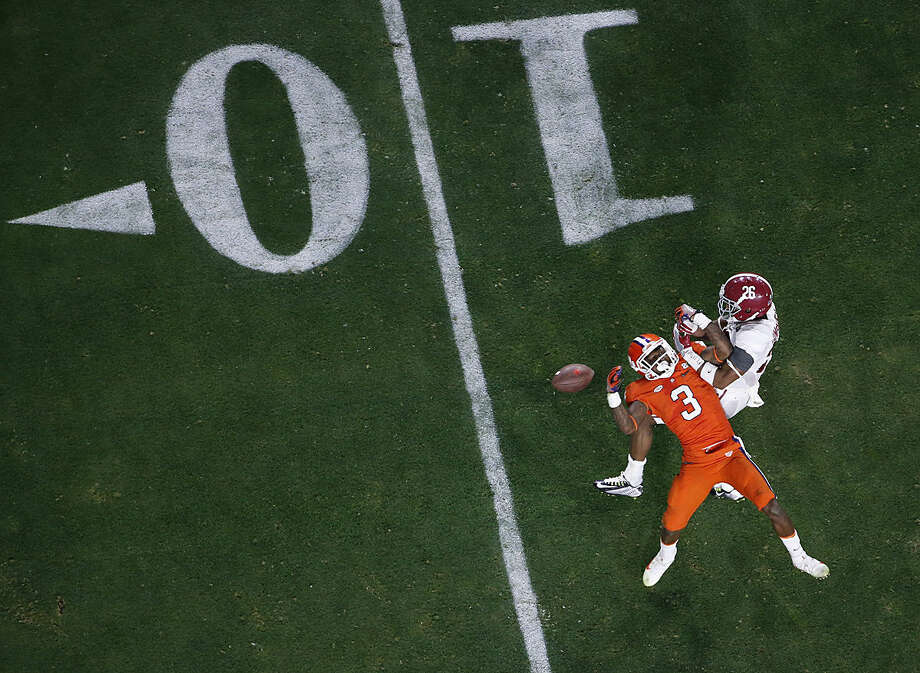 Alabama's Marlon Humphrey (26) breaks up a pass intended for Clemson's Artavis Scott (3) after the NCAA college football playoff championship game Monday, Jan. 11, 2016, in Glendale, Ariz. Alabama won 45-40. (AP Photo/Ross D. Franklin)