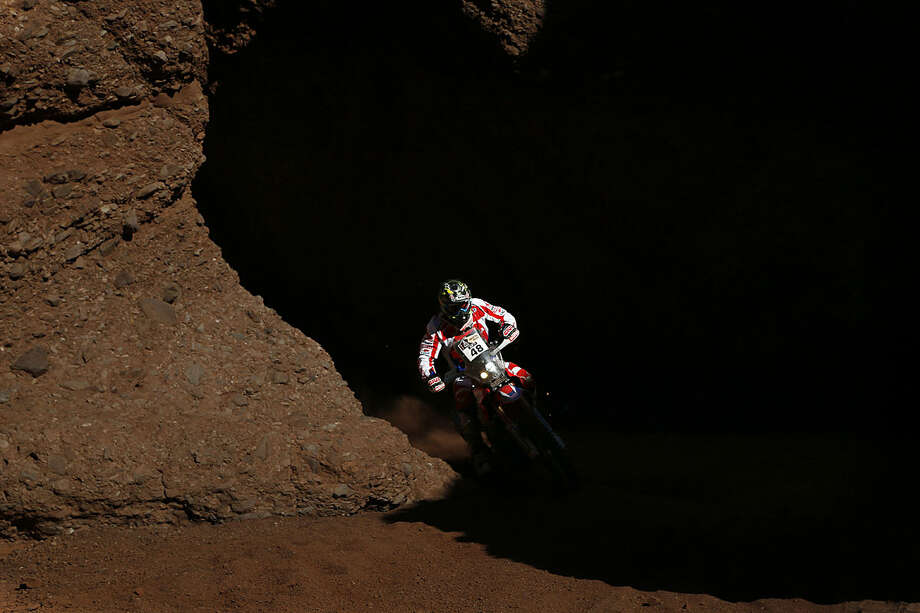 Honda rider Ricky Brabec, from the U.S., races during the eighth stage of the Dakar Rally in Cafayate, between Salta and Belen, Argentina, Monday, Jan. 11, 2016. (AP Photo/Jorge Saenz)