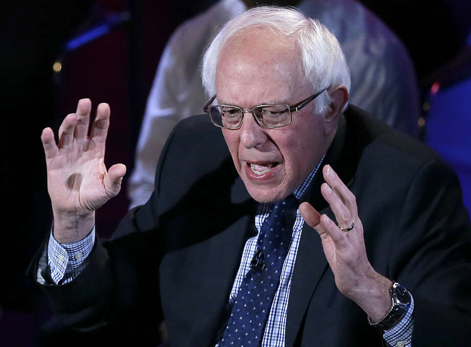 Democratic presidential candidate, Sen. Bernie Sanders, I-Vt, argues a point during the Brown & Black Forum, Monday, Jan. 11, 2016, in Des Moines, Iowa. (AP Photo/Charlie Neibergall)