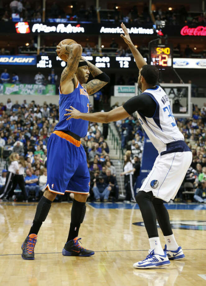 New York Knicks forward Kenyon Martin looks to pass around Dallas Mavericks forward Brandan Wright (34) during the first half of an NBA basketball game, Sunday, Jan. 5, 2014, in Dallas. (AP Photo/Sharon Ellman)