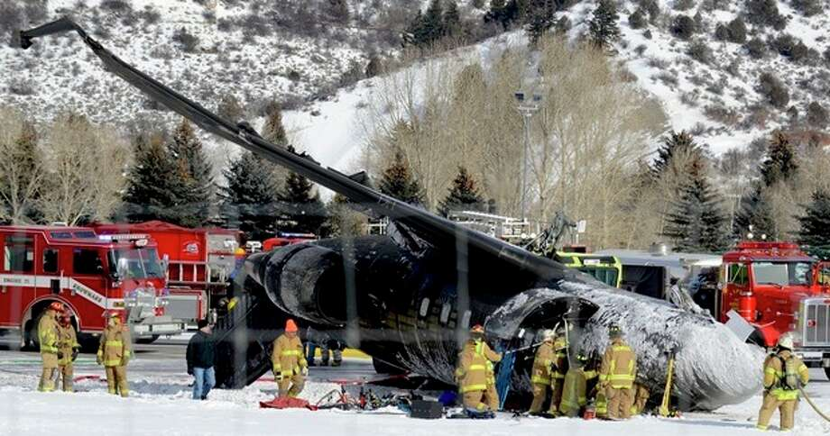 AP Photo/The Aspen Times, Leigh VogelEmergency crews work near a passenger plane that crashed upon landing at the Aspen-Pitkin County Airport in Aspen, Colo. on Sunday. / The Aspen Times