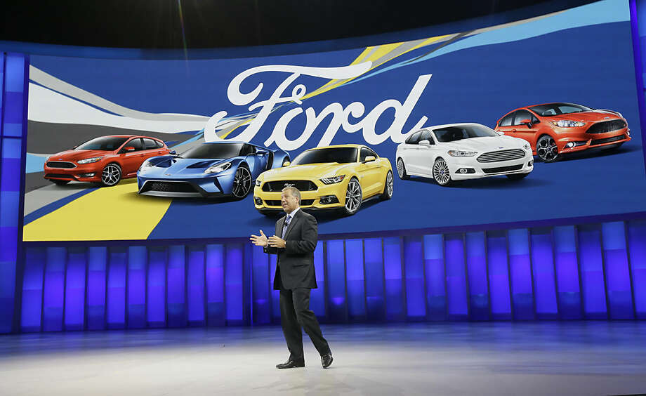 Joe Hinrichs, executive vice president and president of the Americas for Ford Motor Company, addresses the media at the North American International Auto Show, Monday, Jan. 11, 2016, in Detroit. (AP Photo/Carlos Osorio)