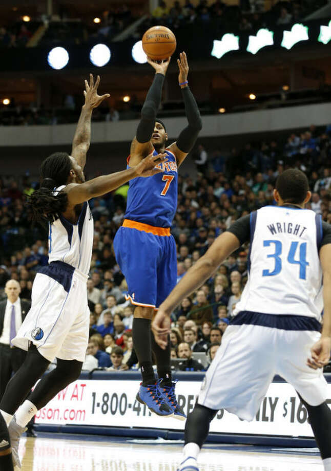 Dallas Mavericks forwards Jae Crowder (9) and Brandan Wright (34) defends as New York Knicks forward Carmelo Anthony (7) takes a shot during the first half of an NBA basketball game, Sunday, Jan. 5, 2014, in Dallas. (AP Photo/Sharon Ellman)