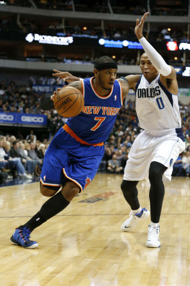 New York Knicks forward Carmelo Anthony (7) drives around Dallas Mavericks forward Shawn Marion (0) during the first half of an NBA basketball game, Sunday, Jan. 5, 2014, in Dallas. (AP Photo/Sharon Ellman)
