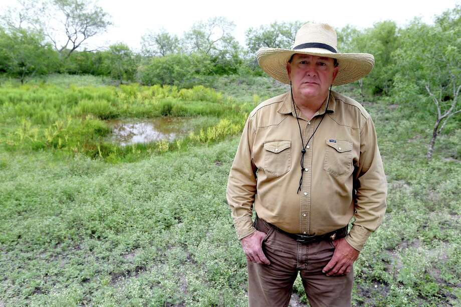Tommy Shockome stands May 31 in front of a pond on his property near Kenedy that he says was filled with the contents of a frac water pond when it was drained by a drilling company from a neighbor's property onto his property. Even though it's been several weeks since the incident happened, Shockome says he still doesn't know what was in that frac water. Photo: William Luther /San Antonio Express-News / © 2016 San Antonio Express-News