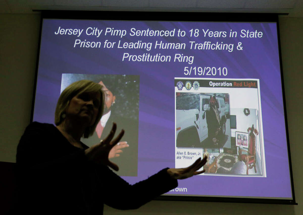 In this Thursday, Dec. 19, 2013 photograph, Kathleen Friess gives a presentation on human trafficking in Hamilton Township, N.J., for hotel and nightclub employees and tries to dispel notions of what human trafficking looks like. Often, Friess said, it?'s a local woman forced into sex work by a man she initially thought had romantic intentions. Officials are training legions of law enforcement personnel, hospitality workers, high school students and airport employees to watch for signs of it before the Feb. 2 football game, when hundreds of thousands of people are expected to descend on New Jersey. (AP Photo/Mel Evans)