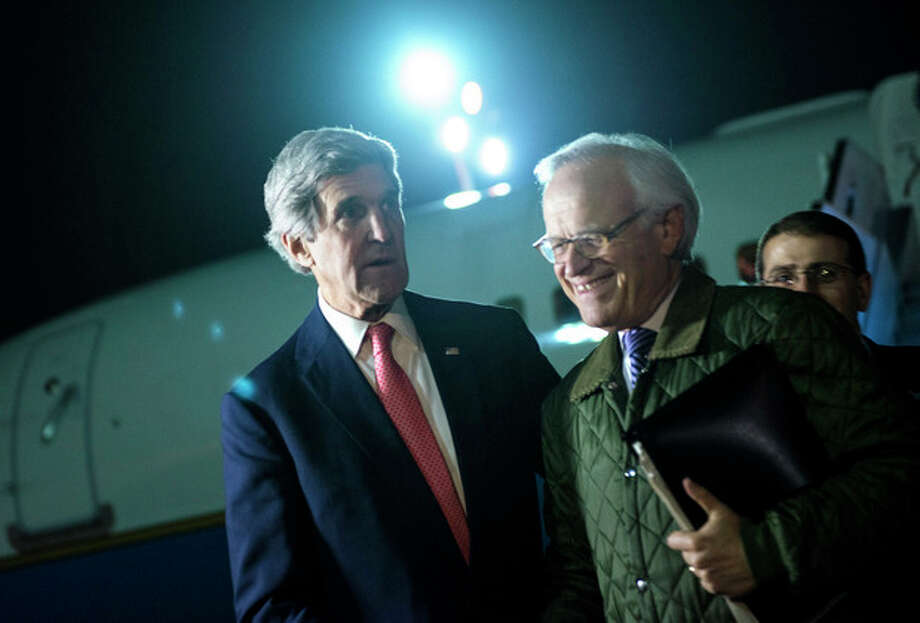 AP Photo / Brendan Smialowski, PoolUS Secretary of State John Kerry, left, walks with US Special Envoy for Israeli-Palestinian Negotiations Martin Indyk, right, while returning from a trip to Jordan and Saudi Arabia, at Ben Gurion International Airport, Tel Aviv Israel, on Sunday Jan. 5. Kerry continues his regional peace-making efforts Sunday. / pool AFP
