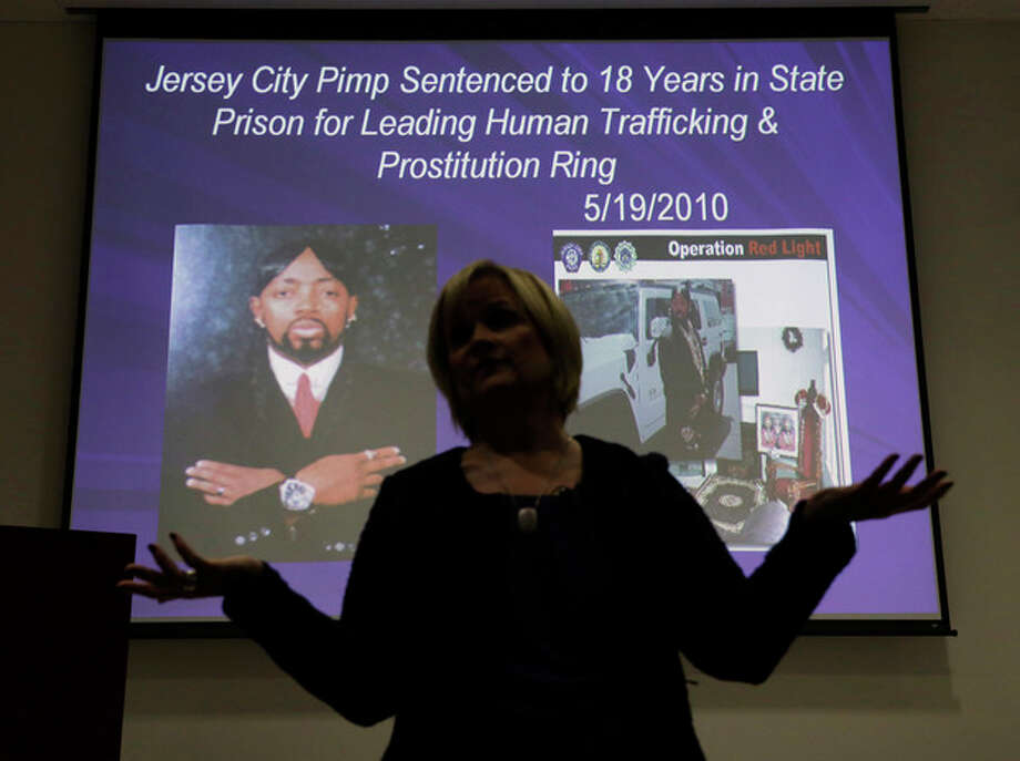 In this Thursday, Dec. 19, 2013 photograph, Kathleen Friess gives a presentation on human trafficking in Hamilton Township, N.J., for hotel and nightclub employees and tries to dispel notions of what human trafficking looks like. Often, Friess said, it's a local woman forced into sex work by a man she initially thought had romantic intentions. Officials are training legions of law enforcement personnel, hospitality workers, high school students and airport employees to watch for signs of it before the Feb. 2 football game, when hundreds of thousands of people are expected to descend on New Jersey. (AP Photo/Mel Evans) / AP