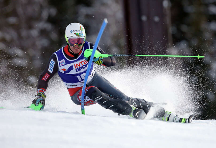 Ted Ligety, of the United States, speeds past a pole during the first run of an alpine ski, men's World Cup slalom, in Bormio, Italy, Monday, Jan. 6, 2013. (AP Photo/Marco Trovati) / AP