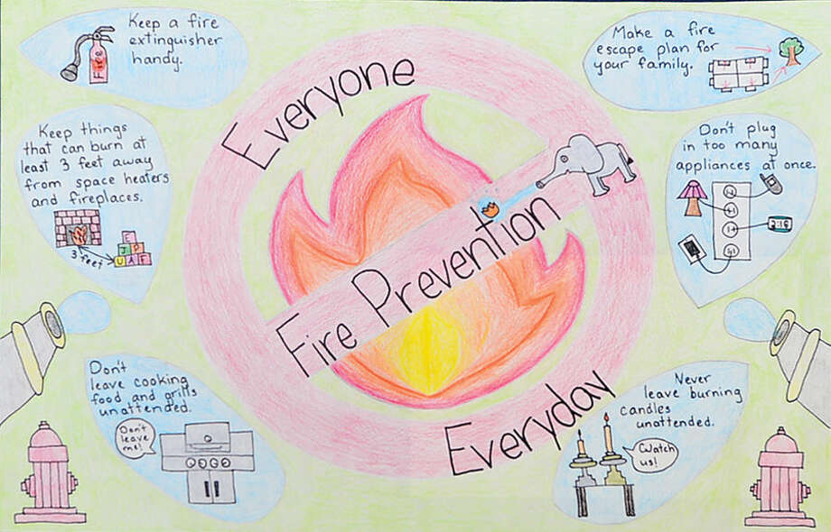 Entry from Cider Mill Elementary School fifth-grade winner Emily Bukowski n the 2014-2015 Connecticut Fire Prevention Poster Contest Thursday morning Wilton Fire Marshal and Wilton Firefighters, Local 2233, presented awards to winners in the competition.