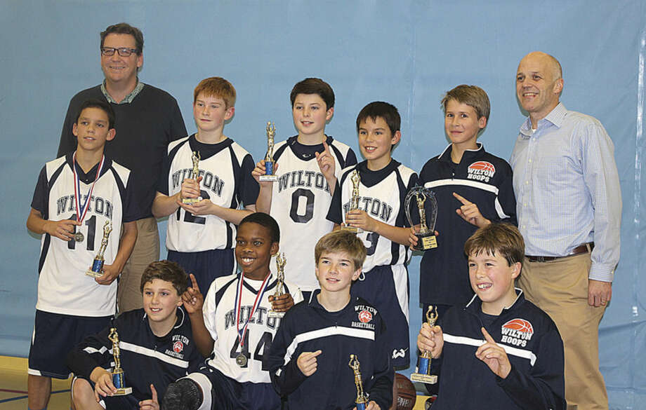 Wilton 6th Grade Boys, sponsored by Pinocchio Pizza Wilton, won the Southern Connecticut Holiday Tournament recently. Team members include, standing from left, Parker Woodring, Asst Coach Sean Byrnes, Max Andrews, Jack Lynch, Max Silva, Matt Giller, and Coach Vic Cunningham, and kneeling, from left, Kevin Hyzy, Zarius Eusebe, Dillon Mannix, Craig Hyzy Missing from photo:Grant Masterson.
