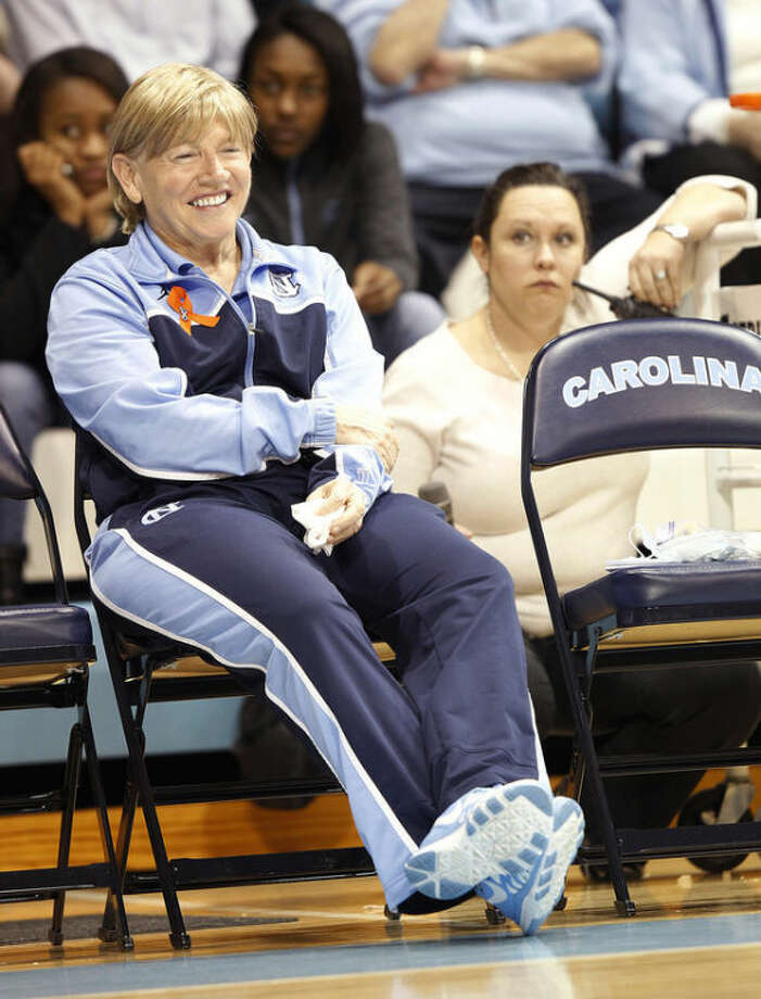 North Carolina head coach Sylvia Hatchell prepares to address the crowd at halftime of an NCAA women's college basketball game against Maryland, Sunday, Jan. 5, 2014, in Chapel Hill, N.C. The Hall of Fame coach has been out all year while she receives treatment for leukemia. (AP Photo/Ellen Ozier)