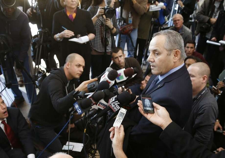 FILE - In this Nov. 24, 2015, file photo, Dean Angelo Sr., Fraternal Order of Police Lodge #7 president, talks to reporters after a bond hearing for Chicago police officer Jason Van Dyke, on murder charges in the killing of 17-year-old Laquan McDonald, in Chicago. After fatally shooting a black teenager 16 times, white Chicago police officer Van Dyke had the option of taking a day or two before internal investigators could interview him. The waiting periods are among the shields specially tailored for officers under union contracts, state laws and departmental directives. Unions defend them, citing uniquely dangerous jobs requiring split-second decisions. (AP Photo/Charles Rex Arbogast, File)