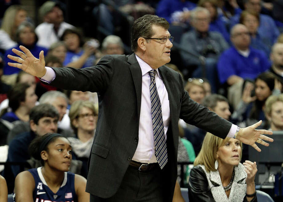 Connecticut head coach Geno Auriemma watches the action in the first half of an NCAA college basketball game against Memphis Saturday, Jan. 4, 2014, in Memphis, Tenn. (AP Photo/Mark Humphrey) / AP