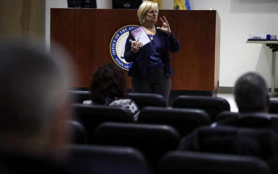 In this Thursday, Dec. 19, 2013 photograph, Kathleen Friess gives a presentation on human trafficking in Hamilton Township, N.J., for hotel and nightclub employees and tries to dispel notions of what human trafficking looks like. Often, Friess said, it's a local woman forced into sex work by a man she initially thought had romantic intentions. Officials are training legions of law enforcement personnel, hospitality workers, high school students and airport employees to watch for signs of it before the Feb. 2 football game, when hundreds of thousands of people are expected to descend on New Jersey. (AP Photo/Mel Evans)