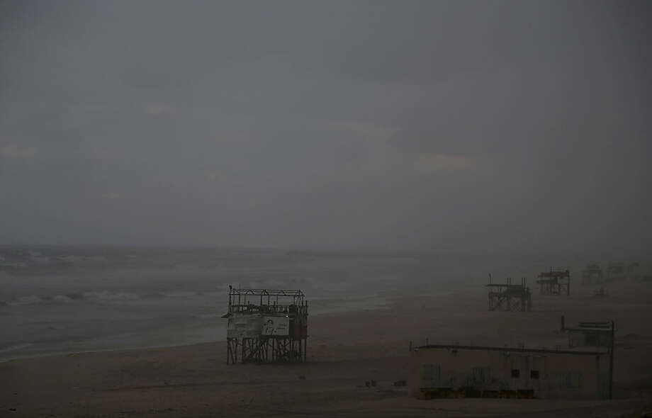 Lifeguard towers line up on the beach along the Mediterranean Sea, as a powerful winter storm swept through the Middle East region, in Gaza City in the northern Gaza Strip, Thursday, Jan. 8, 2015. (AP Photo/Adel Hana)