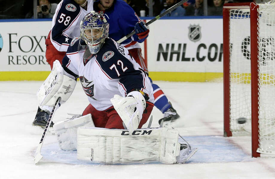 Columbus Blue Jackets goalie Sergei Bobrovsky (72), of Russia, watches a puck shot past the goal during the second period of an NHL hockey game against the New York Rangers Monday, Jan. 6, 2014, in New York. (AP Photo/Frank Franklin II) / AP