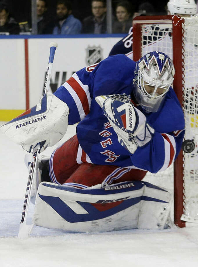 New York Rangers goalie Henrik Lundqvist (30), of Sweden, stops a shot on the goal during the first period of an NHL hockey game against the Columbus Blue Jackets, Monday, Jan. 6, 2014, in New York. (AP Photo/Frank Franklin II)