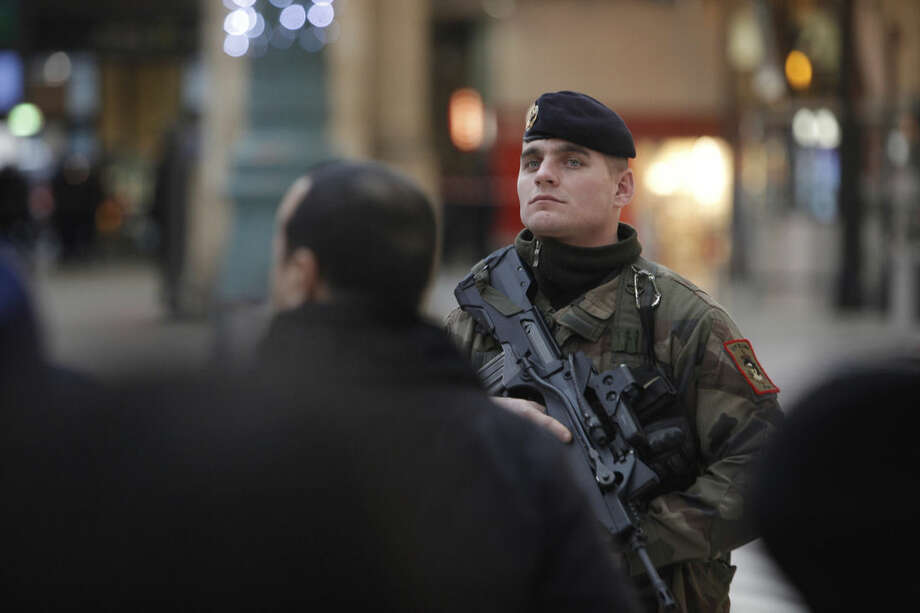 A French soldier patrols at the Gare du Nord railway station, in Paris, France, Thursday, Jan. 8, 2015. Scattered gunfire and explosions shook France on Thursday as its frightened yet defiant citizens held a day of mourning for 12 people slain at a Paris newspaper. French police hunted down the two heavily armed brothers suspected in the massacre to make sure they don't strike again. (AP Photo/Thibault Camus)