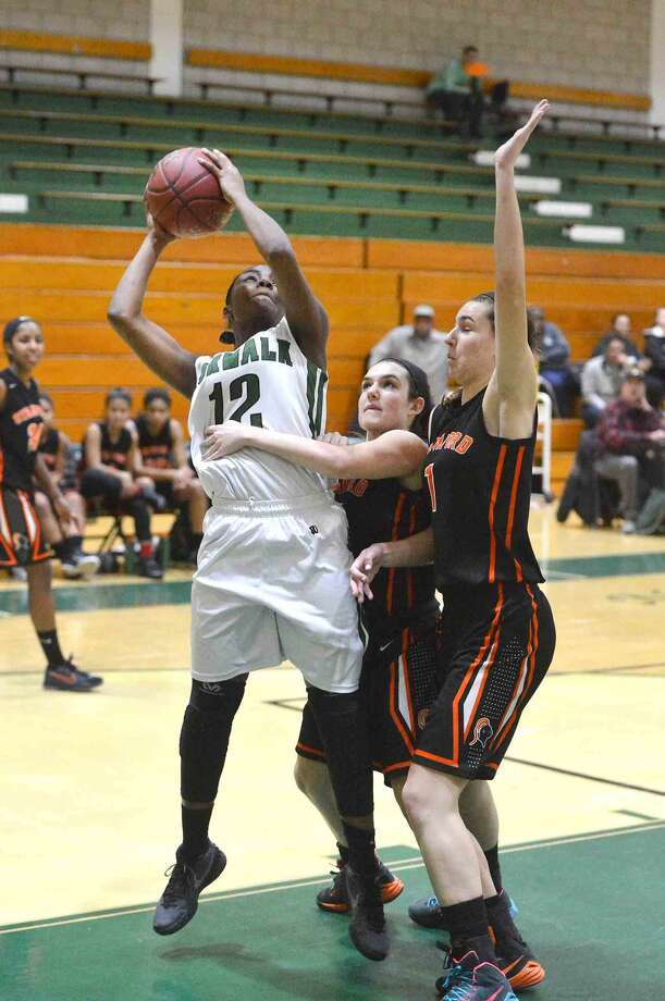 Hour Photo/Alex von Kleydorff Norwalk's #12 Asiah Knight shoots vs Stamford