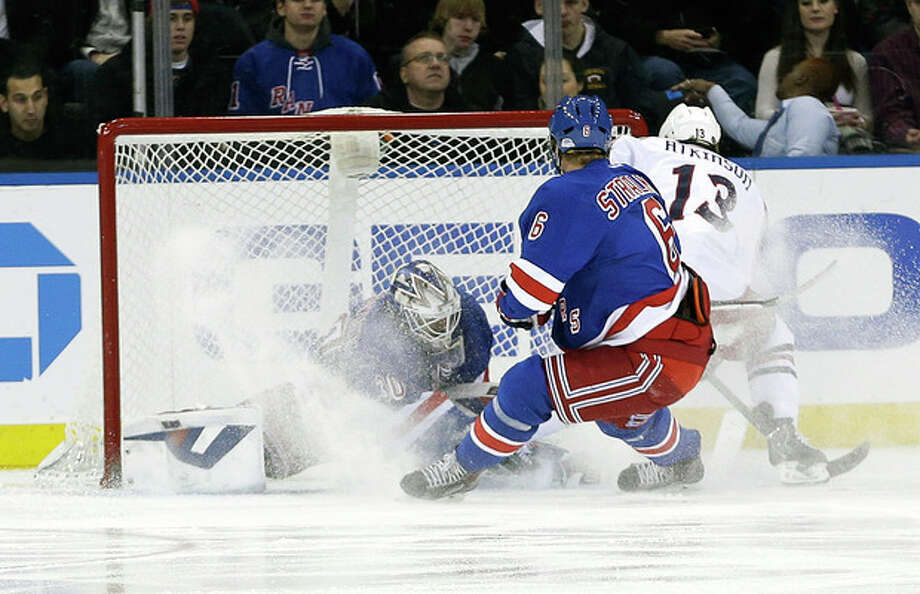 Columbus Blue Jackets' Cam Atkinson (13) scores on New York Rangers goalie Henrik Lundqvist (30), of Sweden, during the second period of an NHL hockey game, Monday, Jan. 6, 2014, in New York. (AP Photo/Frank Franklin II) / AP
