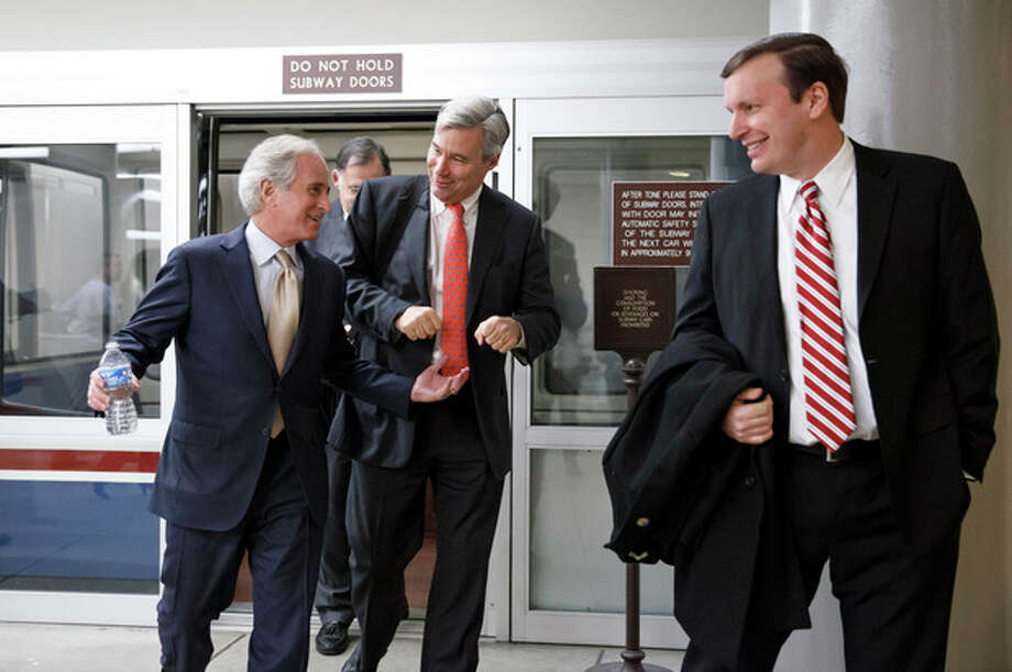 From left, Sen. Bob Corker, R-Tenn., Sen. Sheldon Whitehouse, D-R.I., and Sen. Chris Murphy, D-Conn., arrive for a procedural vote in the Senate on a bill that would extend unemployment benefits, at the Capitol in Washington, Monday, Jan. 6, 2014. Benefits expired for many long-term unemployed Americans on Dec. 28 after lawmakers did not extend the program as part of a bipartisan budget agreement. Sen. Jack Reed, D-R.I., is leading the effort to reauthorize the benefits for three months nationwide, but Republicans are balking however have balked at the proposed extension without offsets for the $6.5 billion that it will cost. (AP Photo/J. Scott Applewhite) / AP