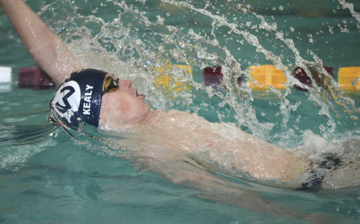 Hour photo/Alex von Kleydorff Wilton's Thomas Kealy swims the 200 individual medley during Monday's meet aganst Ridgefield at the Wilton Y. That was one of the two individual events won by Kealy, who also swam on a pair of triumphant relay teams.