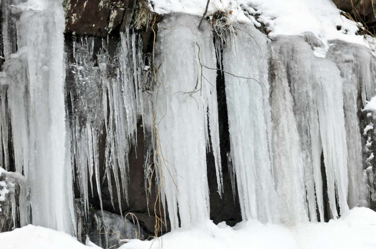 Ice forms off the mountain along S. Centre Street in Mount Carbon, Pa., Sunday, Jan. 5, 2014. (AP Photo/Republican-Herald, Jacqueline Dormer)