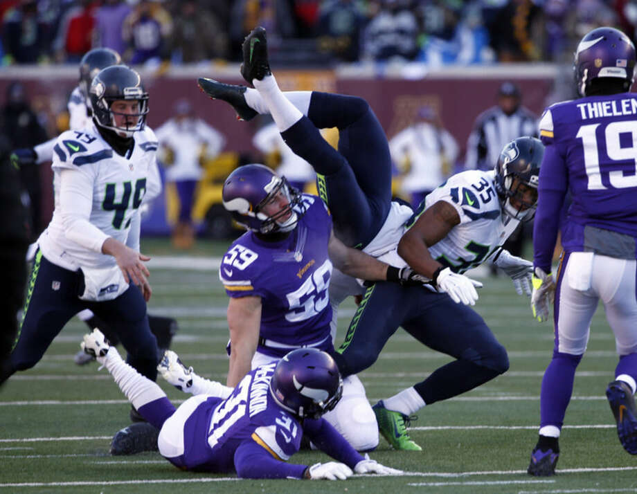 Seattle Seahawks punter Jon Ryan (9) flips over as he run the ball during the first half of an NFL wild-card football game against the Minnesota Vikings, Sunday, Jan. 10, 2016, in Minneapolis. (AP Photo/Jim Mone)
