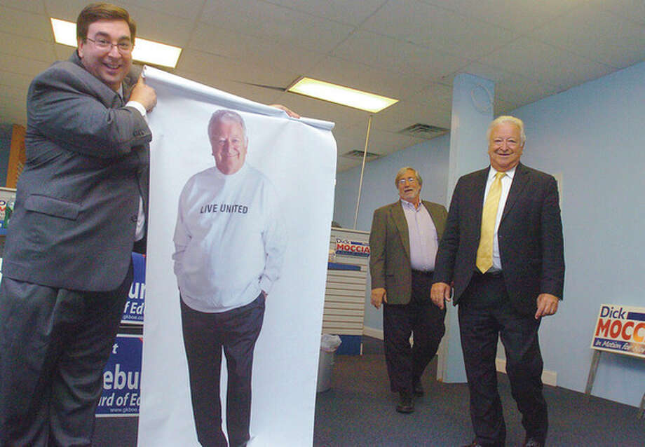 Hour photo / Matthew Vinci Norwalk Republican Town Committee chairman Art Scialabba, Town Clerk candidate Rick McQuaid and Norwalk Mayor Richard A. Moccia attend the opening of the Norwalk Republican Headquarters Tuesday. / (C)2011, The Hour Newspapers, all rights reserved