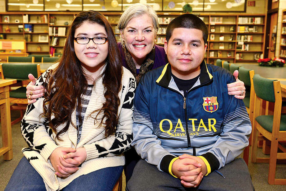 Hour photo / Erik Trautmann Mentor Linda Ross has been mentoring 17-year-old senior Miguel Gutierrez and his 16-year-old sister junior Brenda Gutierrez under the Serving All Vessels Equally (SAVE) Check and Connect program for the past year.