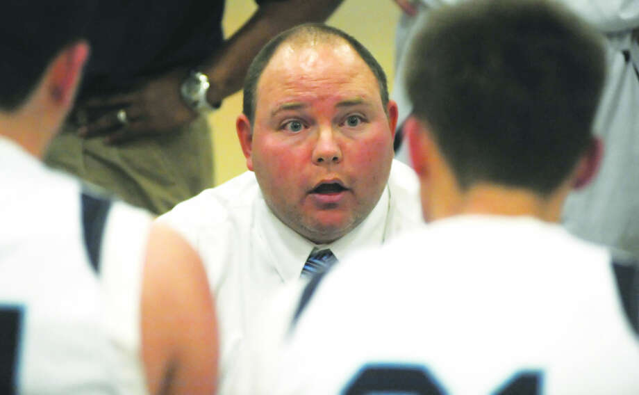 Hour photo/John Nash - Wilton coach Joel Geriak talks to his team during a win over Brien McMahon last week.
