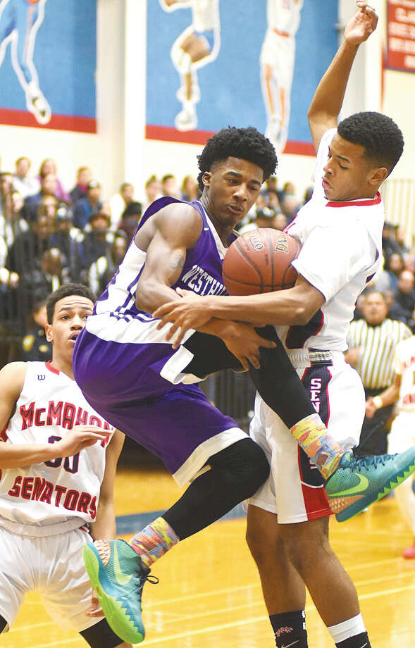 Hour photo/John Nash - Brien McMahon's Marvin Best, right, disrupts the offensive drive of Westhill's Parrish Powell as the Senators' Joe Cantey Jr. looks on during Tuesday's game at Kehoe-King Gym in Norwalk. McMahon moved to 7-0 with a 66-51 win over the Vikings.
