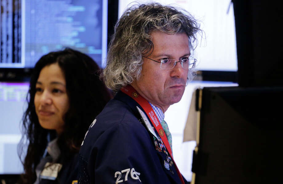 FILE - In this Thursday, Jan. 2, 2014, file photo, Donald Civitanova, a floor official with Knight Capital, works at the New York Stock Exchange, in New York. Stocks are opening higher on Wall Street, Tuesday, Jan. 7, 2014, after a three-day slump that marked the worst start to a year since 2005. (AP Photo/Mark Lennihan, File) / AP