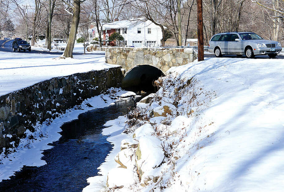 Hour photo / Erik Trautmann Culvert for Keeler Brook at Rowayton Ave. Norwalk looking to buy property at 405 Rowayton Ave. to widen Keeler Brook as part of a long-planned flood mitigation project.