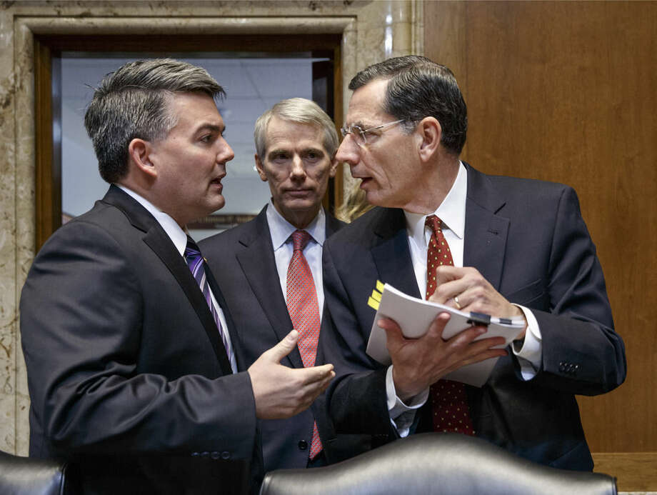 Senate Energy and Natural Resources Committee members, from left, Sen. Cory Gardner, R-Colo., Sen. Rob Portman, R-Ohio, and Sen. John Barrasso, R-Wyo., confer on Capitol Hill in Washington, Thursday, Jan. 8, 2015, as the committee crafts a markup of the long-stalled Keystone XL pipeline bill. The bill, at the top of the GOP agenda, was passed out of the committee and will go to the Senate floor for debate. (AP Photo/J. Scott Applewhite)