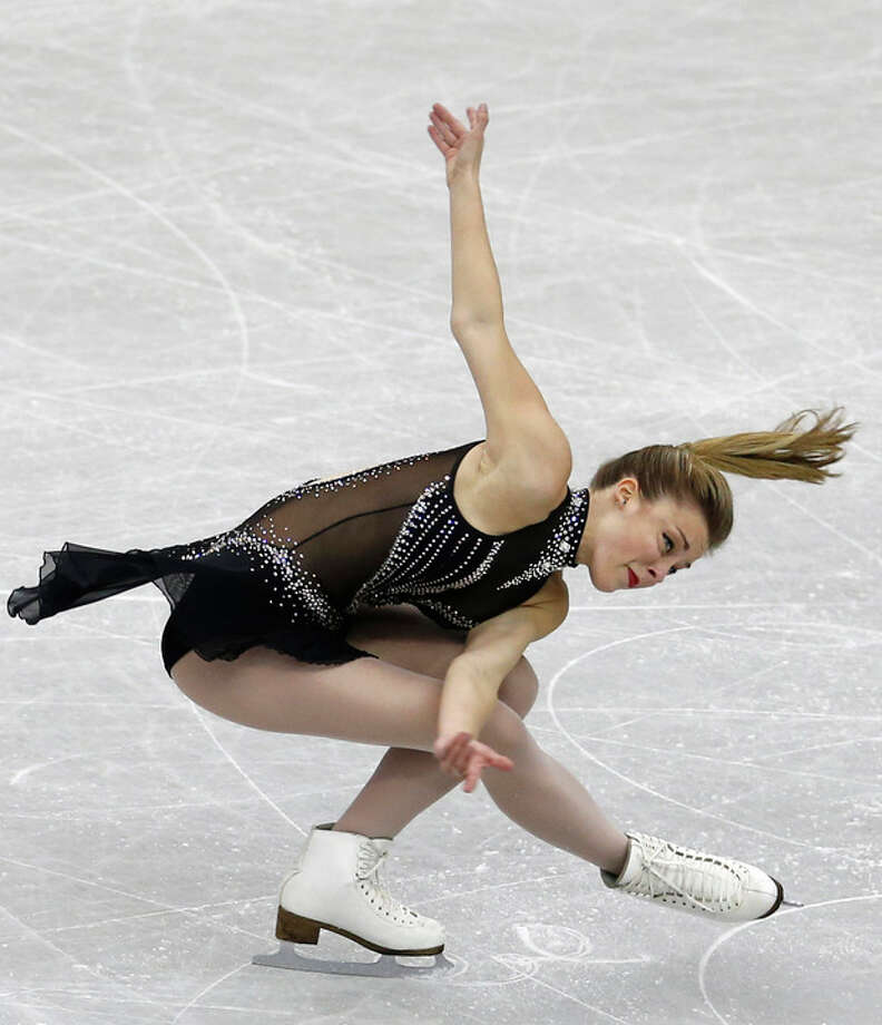 FILE - In this Dec. 5, 2013, file phot, Ashley Wagner, of the United States, performs during the ladies' short program at Grand Prix Final figure skating competition at Marine Messe Fukuoka in Fukuoka, western Japan. Wagner is, by far, the best American bet for an individual medal in Sochi. By finishing fifth at the worlds last year and Gracie Gold getting sixth, they secured the maximum three spots for the Olympics. (AP Photo/Shizuo Kambayashi, File) / AP