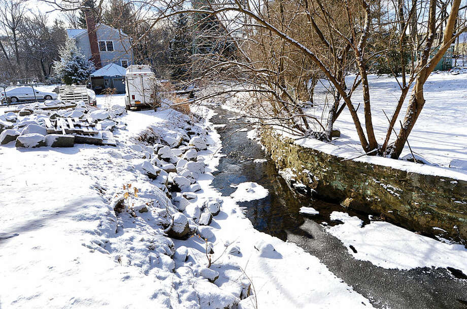 Hour photo / Erik Trautmann Norwalk looking to buy property at 405 Rowayton Ave. to widen Keeler Brook as part of a long-planned flood mitigation project.